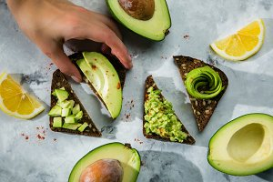 Avocado toasts on marble background