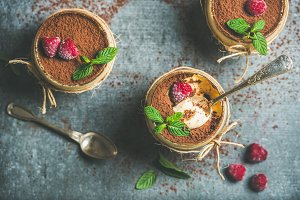 Homemade dessert Tiramisu in glasses with berries and mint