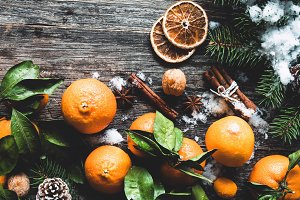 Tangerines, fir tree and snow