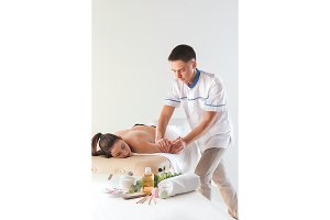 The picture of beautiful woman in massage salon