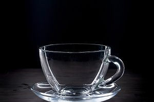 empty cup and saucer on black   back