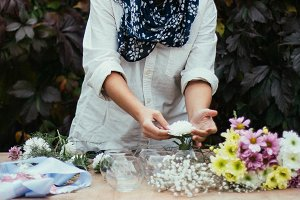 Woman making bouquet of wildflowers.