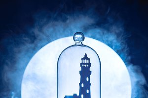 Sea still life with lighthouse silhouette in full Moon. Night ocean scene with smoke on water and copy space. Conceptual paper craft.