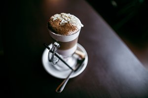 Almond latte with cinnamon on a wood