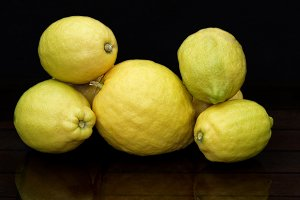 Lemons on black with reflections