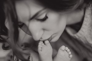 mother kissing feet