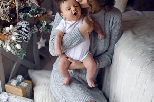 mother with newborn son sitting