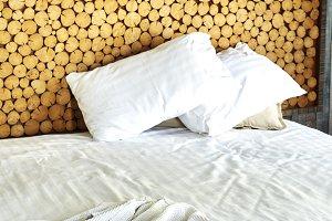 white bathrobe on the bed