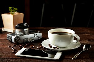 coffee camera and smartphone on wood