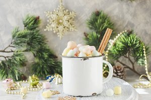 rustic white mug marshmallows for Christmas and New Year on a wooden white table, selective focus