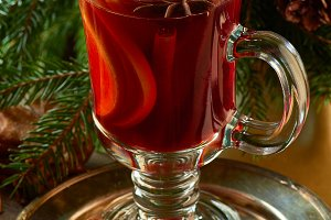Mulled wine with cinnamon sticks,  ginger cookies and spruce branches