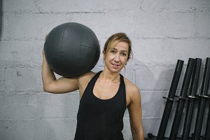 Woman working out with ball