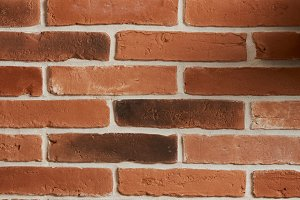 Vertical red brick wall texture