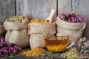 Healing herbs in bags and herbal tea