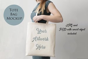 Woman holding tote bag mockup