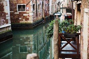 Venetian balcony on the canal .