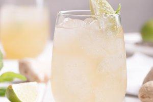 Fresh cocktail prepared with ginger beer, lime and ice