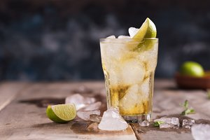 Fresh cocktail on the wooden rustic background