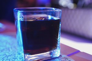 Cola with whiskey in large glass - night club