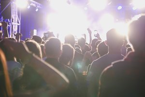 Crowd spectators in auditorium at a rock concert