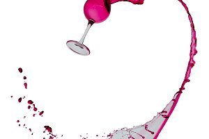 Wineglass with red wine on white isolated background