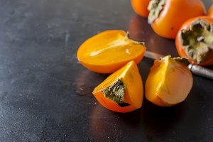Ripe orange persimmons on the black