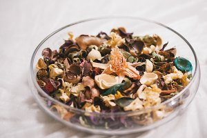 Dried flowers and herbs in glass plate - aromatherapy