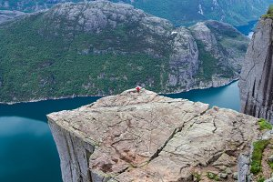 Tourist on the edge at Preikestolen,