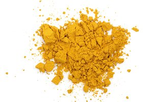 Turmeric or Curcuma powder pile isolated on white background, top view