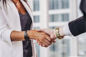Close-up of businesswomen shaking hands greeting each other before meeting