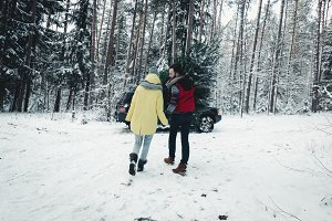 Picking Christmas tree in forest