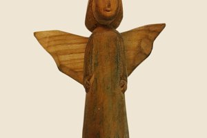 Wooden angel on background