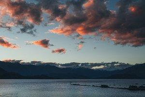 Silhouette walking along lake