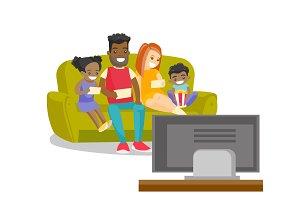 Multiracial family watching television at home.