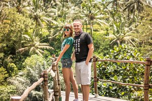 Young romantic honeymoon couple in the jungle rainforest of a tropical island of Bali, Indonesia.