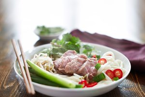 steamy hot pho with rare beef