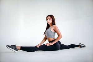 Cute girl doing stretching.