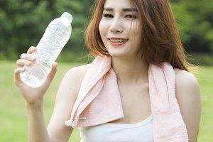 Woman standing water breaks