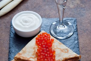 Blini with red caviar  and Vodka