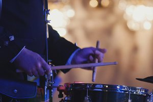 Drum performer plays drumstick at the concert