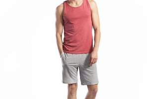 Handsome fitness man in red tank top, studio shot.