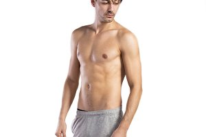 Shirtless fitness man. Studio shot. White background.