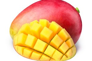 Mango with half sliced to cubes isolated
