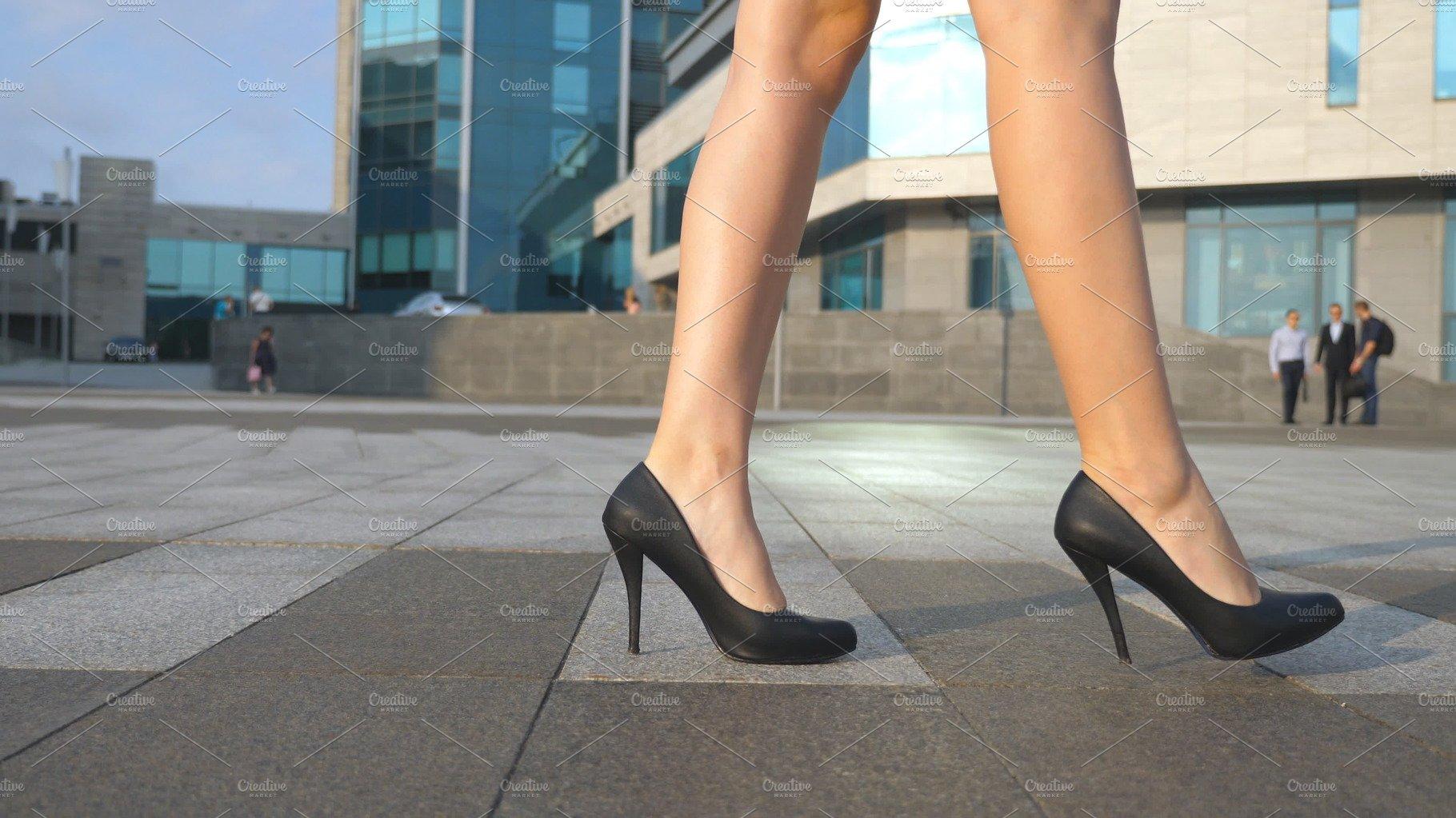 Female legs in high heels shoes walking in the urban ...