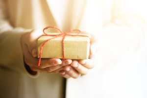 Hand holding red gift box, with copy space