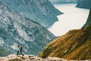 Man running at Naeroyfjord mountains