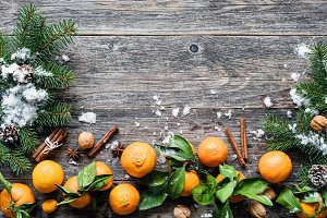 Winter background with tangerines