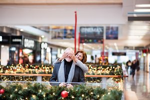 Senior couple doing Christmas shopping.