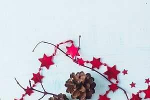 Pine cones, garlands, tree branches on a white wooden background. Christmas decorations concept.
