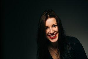 emotional girl smiling on a dark background